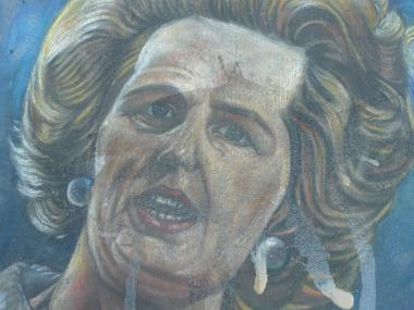 Someone either spilled or poured coffee on a portrait of former British Prime Minister Margaret Thatcher, on the sidewalk on the east side of Broadway near West 106th Street.