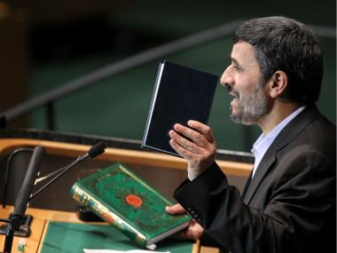 Iranian president Mahmoud Ahmadinejad holds up a Bible and a Koran while addressing world leaders during the General Assembly at the United Nations in September 2010.