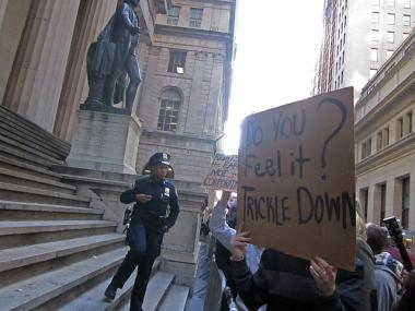 Protesters in front of Federal Hall on Wall Street Monday.