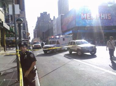 Police closed off Times Square streets for nearly an hour on Monday afternoon, responding to a suspicious package threat.