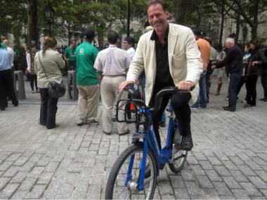 Alex Washburn, an urban designer with the City Planning Department, took a spin on one of the bike-share models Sept. 21, 2011 in Bowling Green.