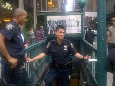 Police stand guard at an entrance to the 7th Avenue subway station on Sept. 22, 2011 after a report of a suspicious package.