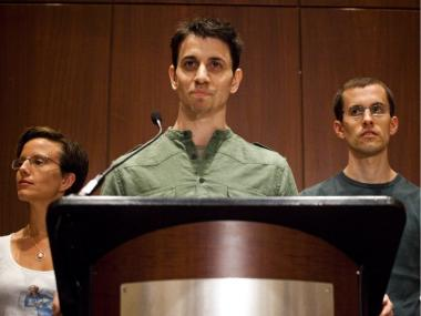 Josh Fattal (C) and Shane Bauer (R), two American hikers released after spending more than two years imprisoned in Iran, were joined by Sarah Shourd (L) and family members in front of a press-filled conference room at the Parker Meridien New York on September 25, 2011.
