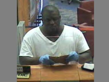 Cops released a surveillance image of the suspect accused of robbing the Sovereign Bank at 2 Gold St.