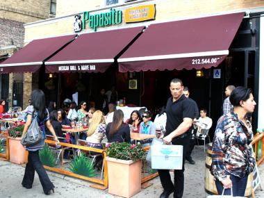 Diners had sidewalk brunch at Papasito's in Inwood. In Williamsburg, the city has started cracking down on Sunday morning sidewalk brunches.