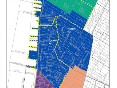 The blue area in this Department of Education diagram represents District 2's current boundaries. The yellow lines indicate the proposed rezoning.