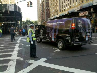 Witnesses say an NYPD traffic cop was hit by a cab at this intersection on Oct. 10, 2011.