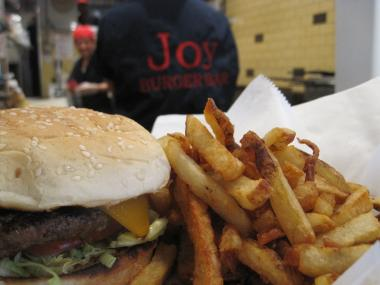 Joy Burger Bar on East 100th Street is part of a stretch of restaurants on Lexington Avenue in East Harlem.