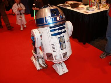 A life size replica R2-D2 wheeled its way through the show room floor. The replica was radio controlled and was a popular photo op for Star Wars fans at New York Comic Con.