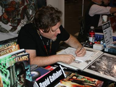 Artist David Gallagher sketches at his booth in the Artist's Gallery section of New York Comic Con.