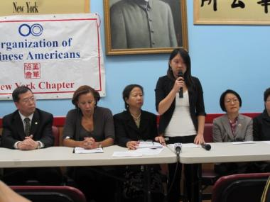 Pvt. Danny Chen's childhood friend Jing Mei Huang (standing) speaks about the late soldier. She joined (from l. to r.) Chinese Consolidated Benevolent Association president Jack Eng, Rep. Nydia Velazquez, OCA-NY president Elizabeth OuYang and Councilwoman Margaret Chin.