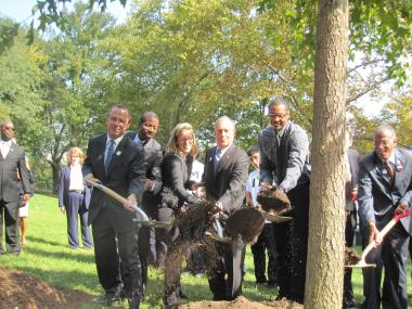 Mayor Michael Bloomberg and New York Knick Carmelo Anthony throw dirt on the 500,000th tree planted as part of city efforts to plant 1 million trees by 2017.