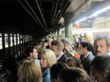 Many passengers waited more than half an hour at the 77th Street Station to board 6 downtown trains Monday morning.