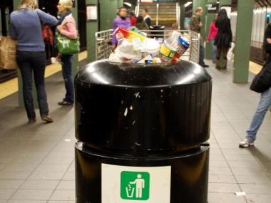 The MTA is attempting to clean up the 8th St. subway station by removing its trash cans.