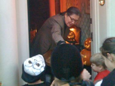 Teri Slater handing out candy to kids from her townhouse at 119 E. 78th St.