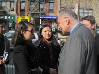 Joanna Chow, 27, and her sister, Susanna, whose grandparents died in the World Wide crash, approached Sen. Schumer in Chinatown to urge him to continue his push for safety improvements.