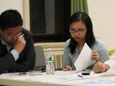 Gigi Li (right), the second vice chair of CB 3, drafts a letter requesting a transparent and fast investigation into the death of Pvt. Danny Chen.