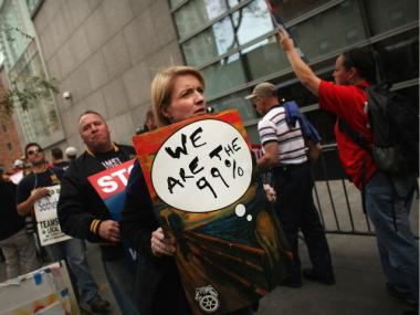 Members of the Occupy Wall Street community join Teamsters in front of the auction house Sotheby's to protest the lockout of union art handlers in a contract dispute on Oct. 18, 2011.