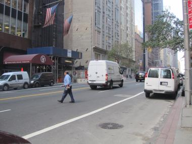 A man jaywalks on West 57th Street, where the DOT plans to build a new crossing.