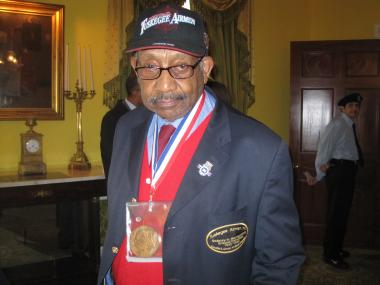 Dabney Montgomery, 88, often wears a hat honoring the Tuskegee Airmen. He is also seen here with a Congressional Medal around his neck.
