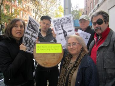 Six members of the group Hands Off St. Vincent's gathered on West 12th Street on Monday, marking one week of protests there calling for developer Rudin Management to bring a full-service hospital back to the Village.