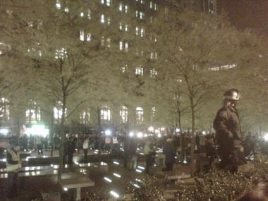 People re-entering Zuccotti Park at 5.40 p.m. after the early morning raid and subsequent judge's ruling to allow protesters back in, but without sleeping equipment.