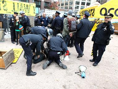 NYPD officers arrest Occupy Wall St., protesters and journalists in Duarte Square, NYC on Nov. 15th, 2011.