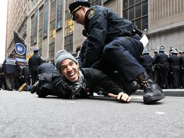 Police arrest an Occupy Wall Street protester during the day of protest, Nov. 17, 2011.