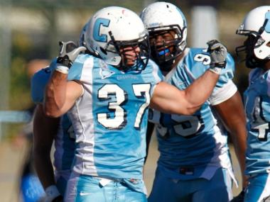 Football player from Columbia University gets pumped.