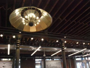 Two of the Puck Building's original chandeliers were inverted, equipped with energy-efficient lighting and rehung overhead, REI store manager Les Hatton said.