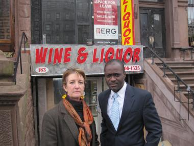 Ruthann Richert and  Laurent Delly, board members of the Mount Morris Park Community Improvement Association, say the design of this liquor store at 183 Lenox Avenue does not fit in with the historic district.