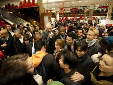 Bargain hunters shop for discounted merchandise at Macy's on 'Black Friday' on Nov. 25, 2011.
