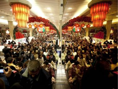 Crowds flooded Macy's at midnight on Black Friday, Nov. 25, 2011.