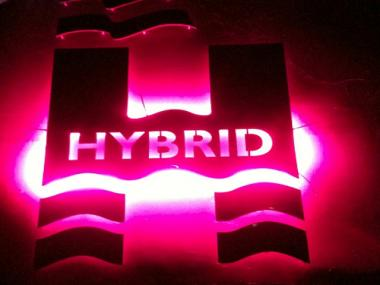 This logo appears on the side of the Hornblower Hybrid yacht.