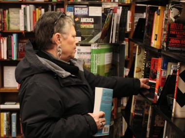 A St Mark's Bookshop customer, Francoise Letondeux, browses the bookshelves on Thursday night.