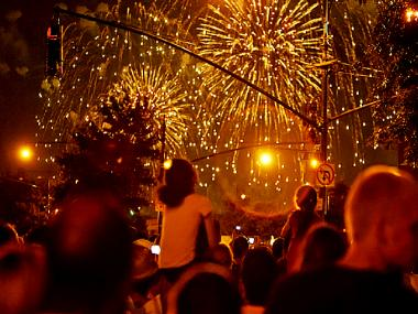 Spectators watch Fourth of July fireworks from Manhattan.