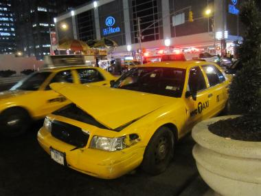 A taxi veered onto the sidewalk Monday night at Sixth Avenue and W. 54th Street.