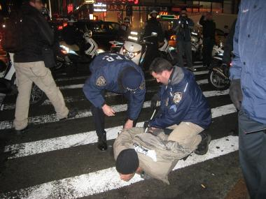Occupy Wall Street protester arrested in Times Square on Dec. 17, 2011 after an earlier clash with cops at Duarte Square.