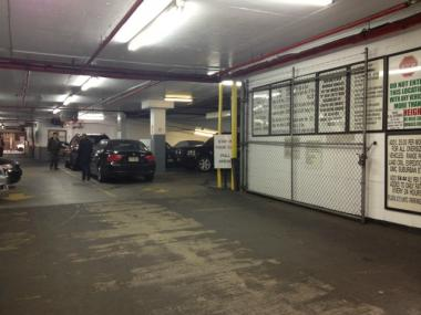 One of the suspects fled into a parking garage on West 58th Street after the mugging, police and witnesses said.