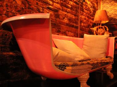 A bathtub at Revision Bar and Gallery in the East Village has been converted into a couch.