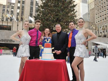 (L-R) Rockette Karen Ritchie, figure skater Kurt Lingenfelter, figure skater Colleen McGuire, Patina Restaurant Group CEO Nick Valenti, figure skater Josiah Modes and Rockette Rhonda Kaufman Malkin celebrate the 75th anniversary of the Rockefeller Center ice skating rink on Dec. 22, 2011.