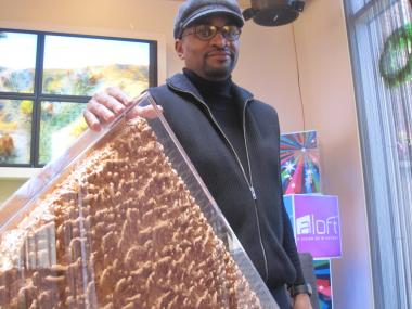 Harlem artist LeRone Wilson with his work 'Golden Triumph'