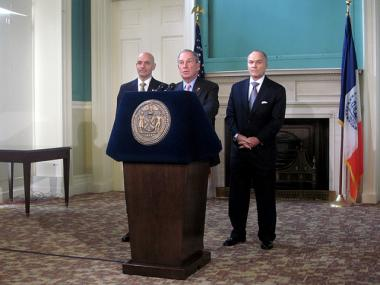 Fire Commissioner Salvatore Cassano, Mayor Michael Bloomberg and Police Commissioner Raymond Kelly (l-r) discuss the year's crime and fire safety numbers on Dec. 26, 2011.