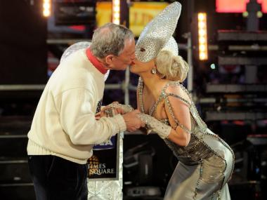 Singer Lady Gaga and New York Mayor Michael Bloomberg share a kiss as they celebrate the beginning of the new year at New Year's Eve 2012 in Times Square on January 1, 2012 in New York City.