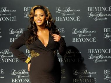 A pregnant Beyonce hosts the screening of 'Live at Roseland: The Elements of 4' at the Paris Theatre on November 20, 2011 in New York City.