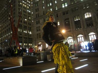 "Lauren Digioia, an Occupy Wall Street protester, celebrated by wearing ""Caution"" tape that had restricted an area of Zuccotti Park after barricades were taken down there on Jan. 10, 2012."