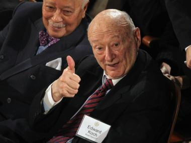 Former New York Mayors Ed Koch (R) and David Dinkins look on before New York Mayor Michael Bloomberg delivers his annual State of the City address at Morris High School Campus on January 12, 2012 in the Bronx borough of New York City. Education reform was a significant part of Bloomberg's address.
