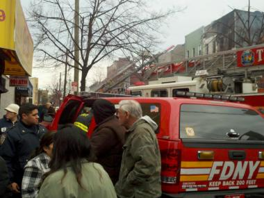 Firefighters work to extinguish a blaze in an apartment building on Himrod Street in Bushwick on Jan. 17, 2012.