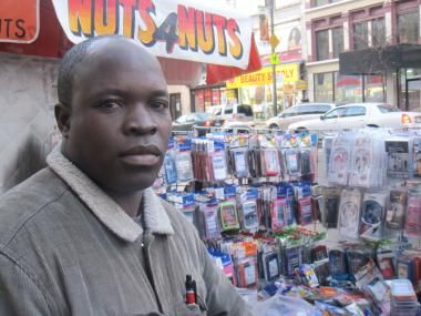 Cell phone accessories vendor Issouf Dabre says he is licensed but didn't think last week's sweep of vendors on 125th Street was fair.