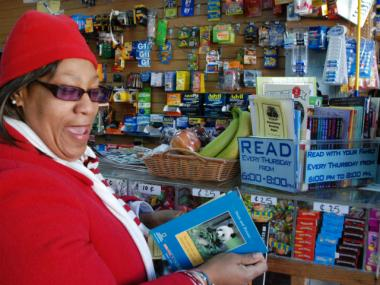 MS 223 parent Claudette Wright discovers a free book bin at Reem II Deli on Willis Ave. in Mott Haven.